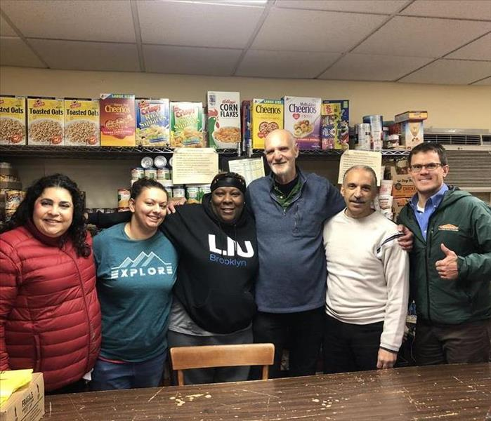 Hanneh and John with Center for Food Action employees