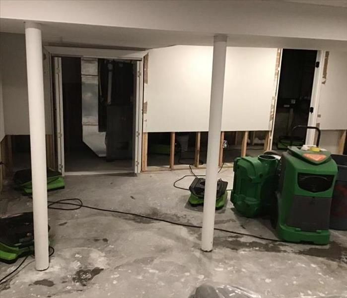 Cut out drywall with air movers and dehumidifier in basement