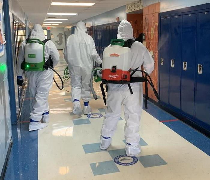 Are those Ghost Busters? Image of group of technicians in PPE.
